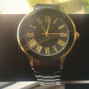 Anne Klein black and gold watch.